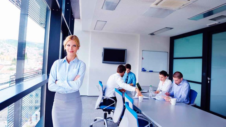 bigstock-business-woman-with-her-staff-38908087.jpg